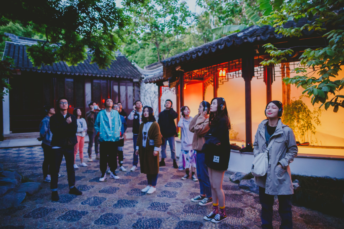 A group of performers stages an immersive play near Suzhou's Pingjiang Road. They are part of a small theater project that aims to boost the city's economy.