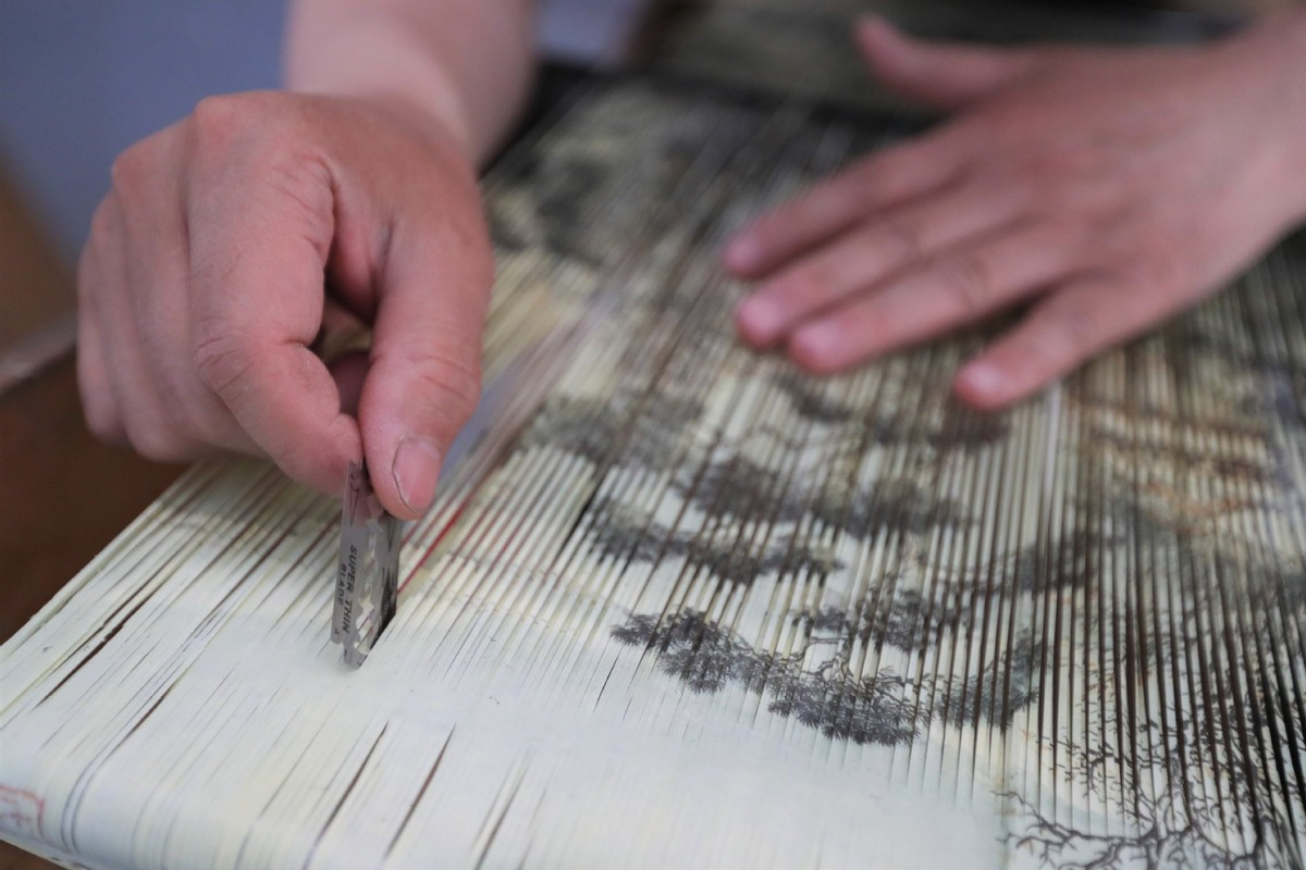 Paper-weaving painting an intricate, painstaking process